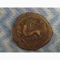 Древний г.Херсонес, античная монета, дева с луком и грифон