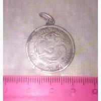 Китайская серебряная медаль