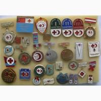 Значки Красного Креста и Полумесяца