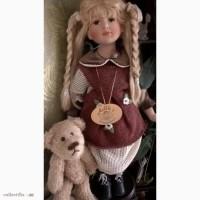 Продам коллекционную фарфоровую куклу